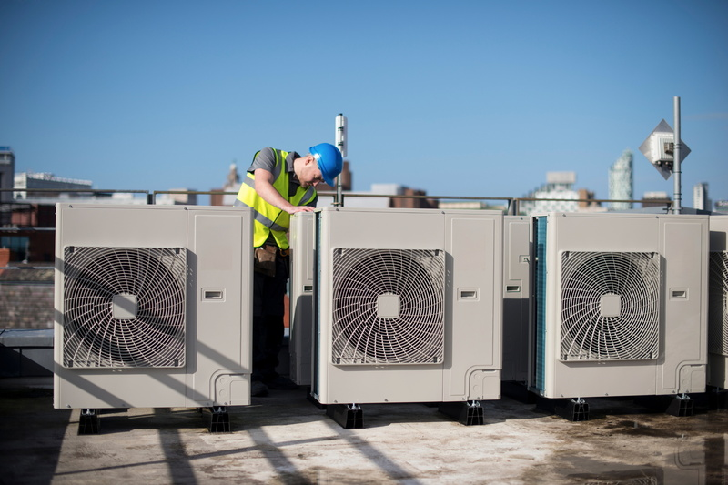 three-rooftop-ac-units-maintenance