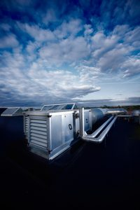 commercia-HVAC-unit-cloudy-sky
